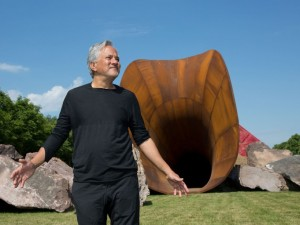 Anish Kapoor poses in front of his artwork named'Dirty Corner' at the opening of his exhibition of his works in the gardens of the Chateau de Versailles. Anish Kapoor's exhibition at Palace of Versailles. Versailles, FRANCE-05/06/2015./MEIGNEUX_meigneuxA022/Credit:ROMUALD MEIGNEUX/SIPA/1506051851